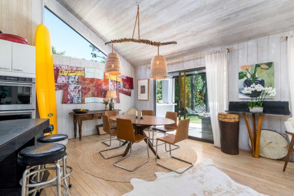 dining room in surf legends malibu beach pad