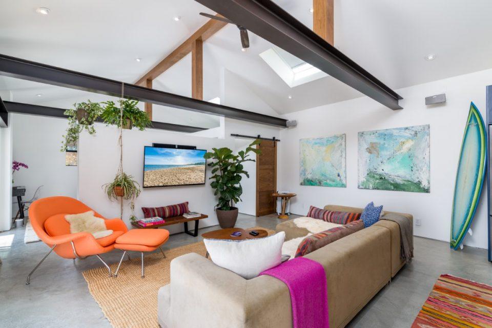 living room furniture and tv in surf legend malibu beach pad