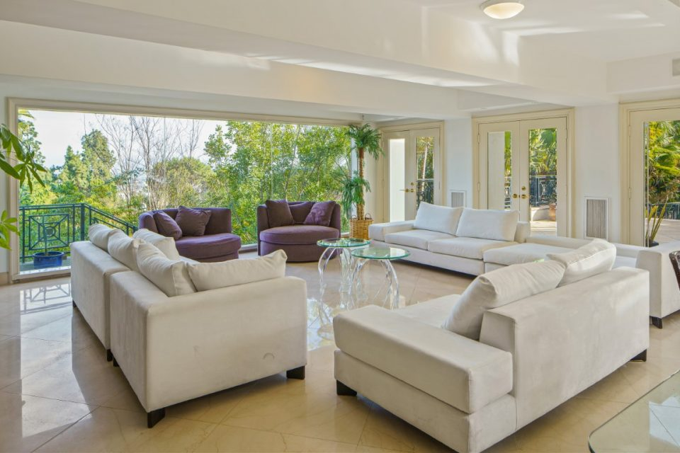 living room furniture surrounding glass tables